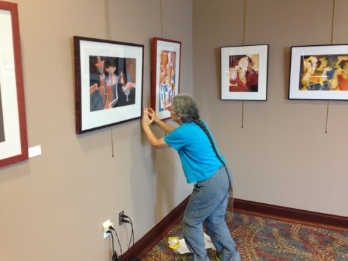 Art Show - Me hanging title cards with paintings, RVM July 2015